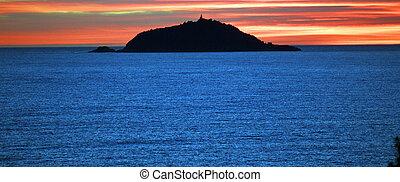 Tino island at the sunset