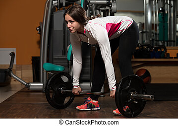 Young Woman Doing Deadlift For Back - Young Woman Lifting...