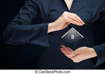 Property insurance and security concept. Protecting gesture...