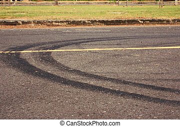 Tire tracks on the road