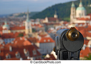 Old telescope and cityscape