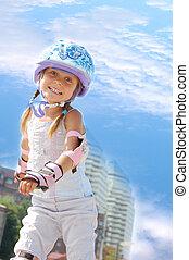happy girl on in-line skates