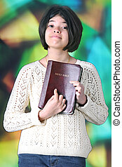 Tweem Proudly Displaying Her Bible - A pretty tween girl...