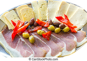 barrels filled with delicacies cheese ham olives and peppers...