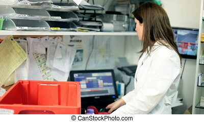 Pharmacist woman at work in back of store