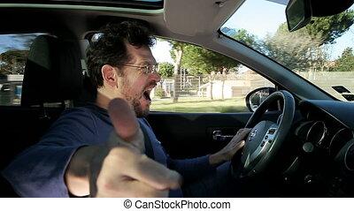 Man shouting into camera driving