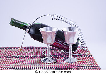 Two silver cups and a bottle of wine