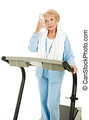 Fit Senior Woman - Sweaty and Tired - Senior woman on a...