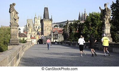 prague cityscape - prague, jogging on charles bridge