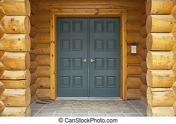 Log Home Front Door Detail - Close up view of a log cabin...