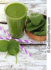 Spinach smoothie on paint wooden board