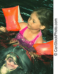 little girl and dolphin