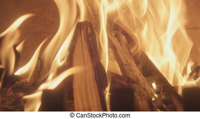 fireplace with burning wood - burning sticks of fire in slow...