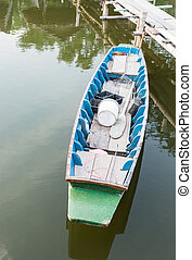 Wooden rowboat of fisherman near the berth
