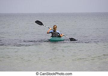 Girl canoeing