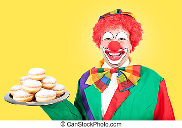 clown with berlin pancakes on yellow background