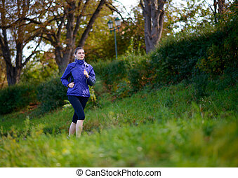 Young Beautiful Woman Running in the Park