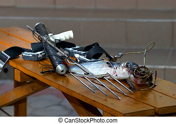 Harpoon catch - Harpoon rifle with a small trophy fish on...