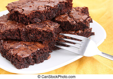 Brownies - Chocolate fudge brownies on a plate with fork