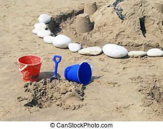 Bucket and spade near sand castles on Bridlington beach