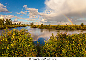colorful Ranibow over the falls and water