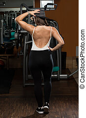 Woman In Gym Showing Her Well Trained Body - Portrait Of A...