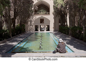 Tourist in Fin Garden in Kashan - Iran. Fountain