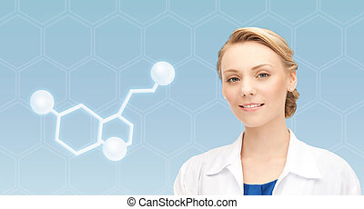 smiling female doctor with molecule of serotonin -...