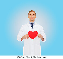 smiling male doctor with red heart - medicine, profession,...