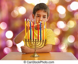 Israeli boy lighting a Hannukah Menorah - An Israeli 8 year...