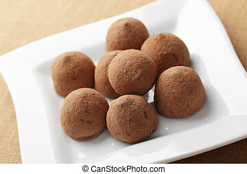 Chocolate truffles on the white square plate