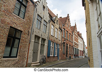 Bruges, Belgium, Flemish old street with bicycle. - Typical,...