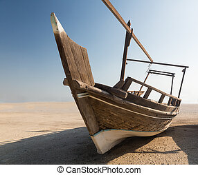 Fishermans boat or dhow on sand - Fishing or fisherman boat...
