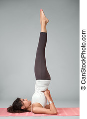 Young woman performing yoga asana - Portrait of young woman...