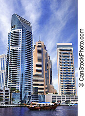 Dubai Marina with boats against skyscrapers in Dubai, United...