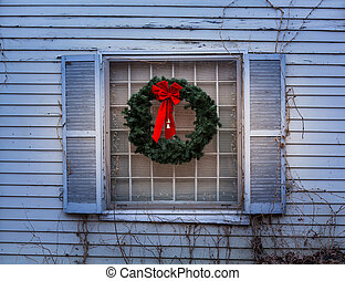 Traditional xmas wreath on window - Traditional design of a...