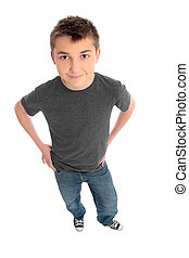 Boy hands on hips looking up at you - A pre teen boy...