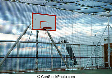 Basketball court at sea - Basketball court and hoop with a...