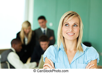 Businesswoman with people at work in a green office
