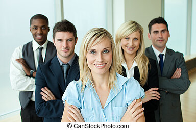 Business people headed by a woman in an office