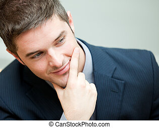 Young interesting businessman  wearing a suit