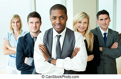 Business people headed by a man in an office