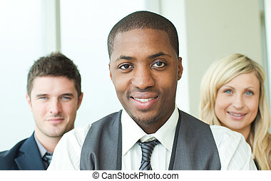 Portrait of an Afro-American businessman with his colleagues...