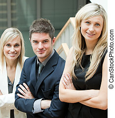 Young Business People with folded arms on stairs
