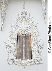 window in Wat Rong khun is known among foreigners as the...