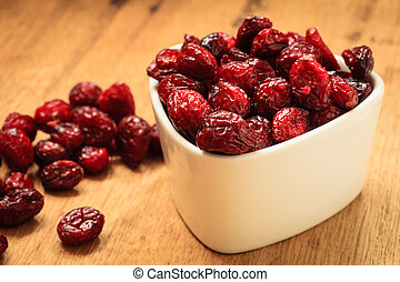 Dried cranberry fruit in bowl on table. - Healthy high fiber...