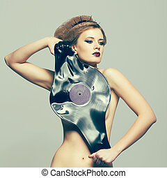 Woman in dress of molten vinyl disk - Woman in dress and...