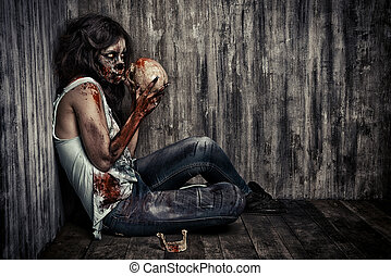 creepy zombie - Frightening bloody zombie girl with a skull...