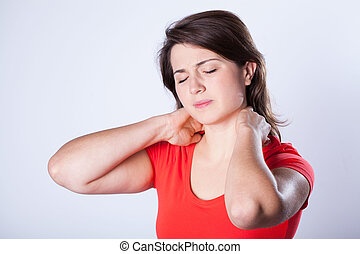 Woman having neck pain - Young woman having neck pain after...