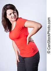 Young woman having back pain - Standing young woman having...